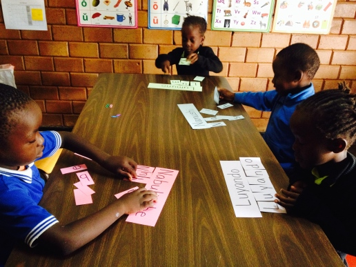 Grade ones learning the letters in their name